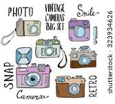 hand drawn set of retro cameras ... | Shutterstock .eps vector #323934626