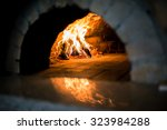 traditional pizza oven  burning ... | Shutterstock . vector #323984288