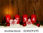 advent candles with snow in...   Shutterstock . vector #324029195