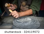 Craftsman Hands Working On A...