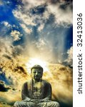 Statue of Buddha in front of a beautiful mystical sky - stock photo
