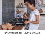 young couple making breakfast... | Shutterstock . vector #324169136