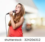 Young Woman Singing With A...