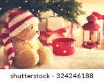 Bear Wearing Santa Hat With...