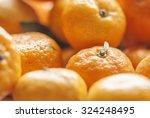 tangerine segments | Shutterstock . vector #324248495