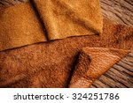 piece of brown leather and... | Shutterstock . vector #324251786