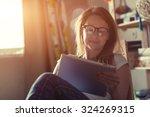 pretty woman with digital... | Shutterstock . vector #324269315