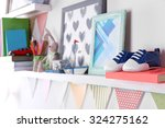 shelves with toys in child room ... | Shutterstock . vector #324275162