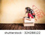 Small photo of Kid with jet pack. Child playing at home. Success, leader and winner concept