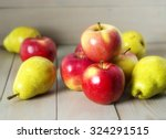 Apples And Pears On A Wooden...