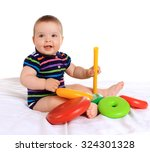 adorable baby boy with toy on... | Shutterstock . vector #324301328