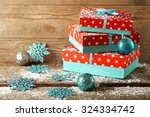 gift boxes on wooden background | Shutterstock . vector #324334742
