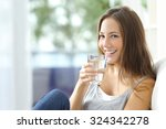 Girl drinking water sitting on...