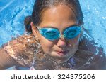 girl swimming | Shutterstock . vector #324375206
