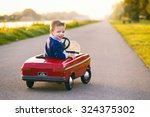 child learns to drive the car | Shutterstock . vector #324375302