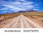 a dirt road in the atacama...   Shutterstock . vector #324376592