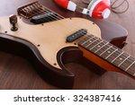 electric guitar with headphones ... | Shutterstock . vector #324387416