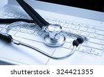 stethoscope on laptop | Shutterstock . vector #324421355