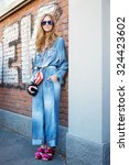 Small photo of MILAN - SEPTEMBER 24: Chiara Ferragni poses for photographers in Fendi dress before Fendi show during Milan Fashion Week Day 2, Spring / Summer 2016 street style on September 24, 2015 in Milan.