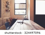 laptop on wooden table in... | Shutterstock . vector #324497096
