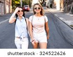 two girls walking in the city.... | Shutterstock . vector #324522626