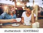 two multi ethnic friends... | Shutterstock . vector #324558662