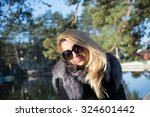 close up of pretty girl with... | Shutterstock . vector #324601442