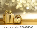 golden gift boxes on abstract... | Shutterstock . vector #324610565