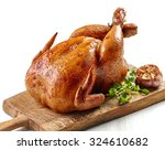 roasted chicken on wooden... | Shutterstock . vector #324610682