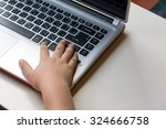 hand of asian boy typing on... | Shutterstock . vector #324666758