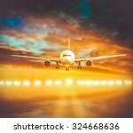 plane lands on the runway on a... | Shutterstock . vector #324668636