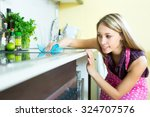 attractive woman cleaning... | Shutterstock . vector #324707576