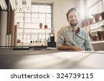 handsome designer entrepreneur... | Shutterstock . vector #324739115