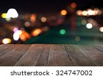 wood table with city lights... | Shutterstock . vector #324747002
