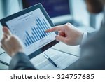businessman pointing at chart... | Shutterstock . vector #324757685