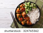 tso's chicken with rice  onions ... | Shutterstock . vector #324765362