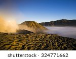 Small photo of Bromo volcano with fumy crater, Java island (Indonesia)