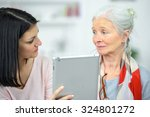 helping old woman use a tablet... | Shutterstock . vector #324801272