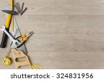 construction tools on a wood... | Shutterstock . vector #324831956