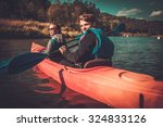 happy couple on a kayaks | Shutterstock . vector #324833126