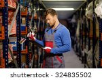 worker on a automotive spare... | Shutterstock . vector #324835502
