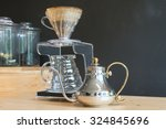 hand drip coffee on wood table | Shutterstock . vector #324845696
