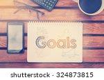 notebook with text inside goals ... | Shutterstock . vector #324873815