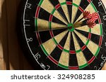 The Darts Isolated On Wooden...