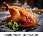 roasted chicken on gray plate | Shutterstock . vector #324966605