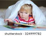 serious preschooler girl...   Shutterstock . vector #324999782