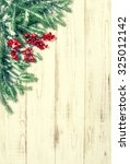 christmas tree branch with red... | Shutterstock . vector #325012142