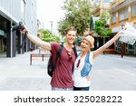 young couple in city posing for ... | Shutterstock . vector #325028222