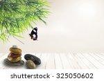 stacked of stone on wood floor...   Shutterstock . vector #325050602