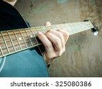 closeup photo of an acoustic... | Shutterstock . vector #325080386